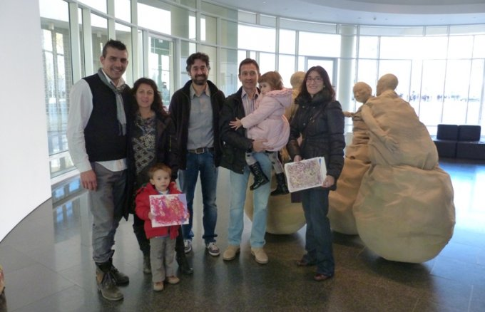 Gonzalo Vázquez, Manager of Social and Cultural Projects at Fundación Repsol, standing at the entrance to the museum with the shareholders and their children